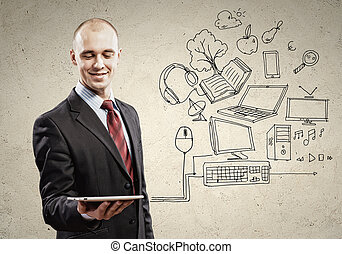 Businessman with ipad in hands