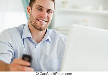 Businessman with laptop and cellphone