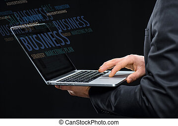 Businessman with laptop computer