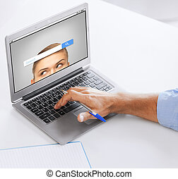 businessman with laptop computer working at office