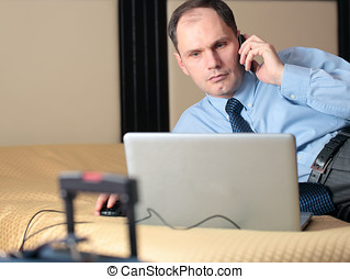 Businessman with laptop in a hotel room