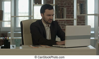 Businessman with laptop in crisis