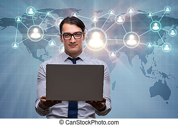 Businessman with laptop in social network concept