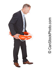 Businessman With Life Buoy