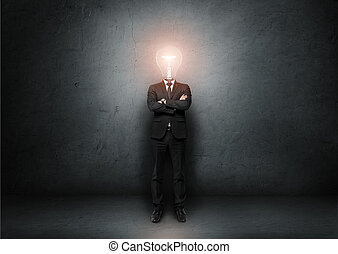 Businessman with light bulb instead of head on concrete room...