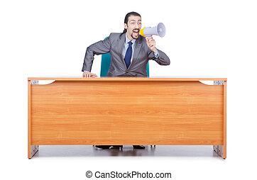 Businessman with loudspeaker at the desk