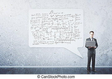 Businessman with mathematical formulas