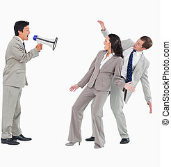 Businessman with megaphone shouting at colleagues