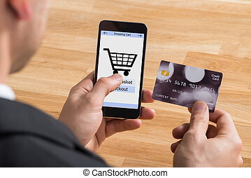 Businessman With Mobile Phone And Credit Card