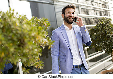 Businessman with mobile telephone