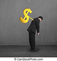 Businessman with money symbol winder on his back concrete...