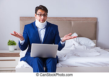 Businessman with neck injury working from home