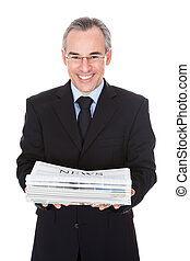 Businessman With Newspaper Stack