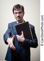 businessman with notebook holding out his hand