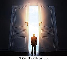 businessman with open door