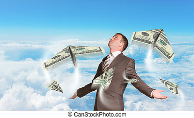 Businessman with paper airplanes made of hundred dollar bills