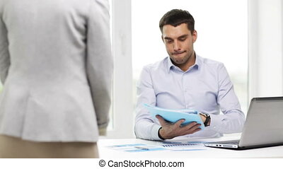 businessman with papers and secretary in office