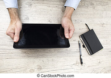 Businessman with phone and tablet