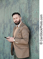 Businessman with phone in the city