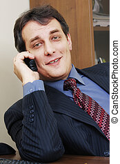 Businessman with phone inclining right