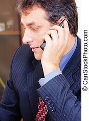 Businessman with phone sideview