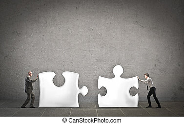 Businessman with puzzle