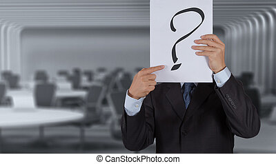 businessman with question book on meeting room background