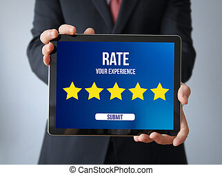 businessman with rating on a tablet