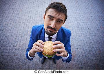 Businessman with sandwich