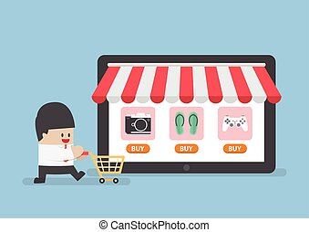 Businessman with shopping cart in front of online store