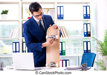 Businessman with skateboard in office
