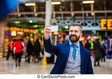 Businessman with smart phone - Young handsome businessman...