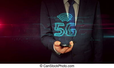 Businessman with smartphone and 5G mobile hologram concept -...