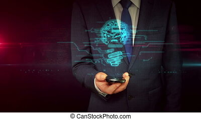 Businessman with smartphone and bulb sign hologram concept -...