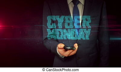 Businessman with smartphone and cyber monday hologram...