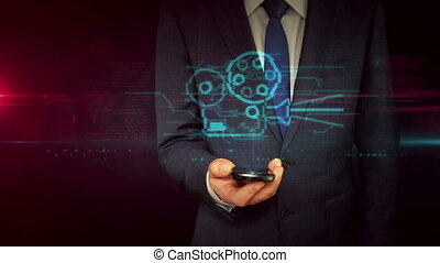 Businessman with smartphone and mobile movie player hologram...