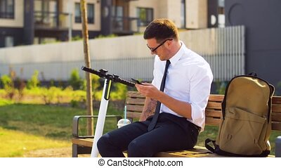 businessman with smartphone drinking smoothie - business,...