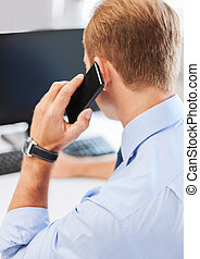 businessman with smartphone in office