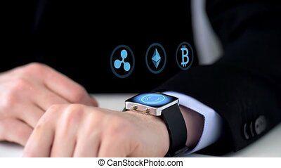 businessman with smartwatch mining cryptocurrency -...