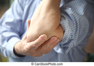businessman with sore elbow
