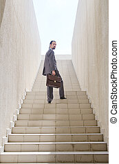 Businessman with stair in business concept