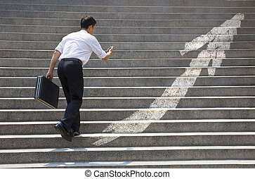 Businessman with stair in business graph concept