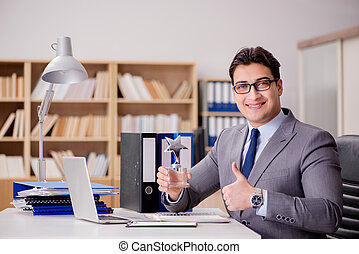 Businessman with star award in office