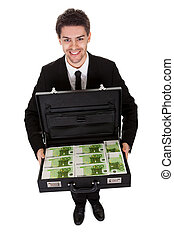 Businessman with suitcase full of cash. Isolated on white