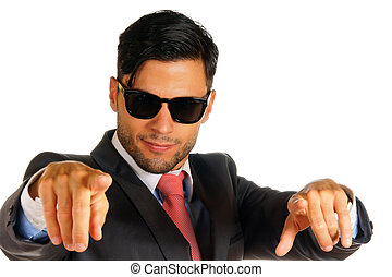 Businessman with sunglasses pointing