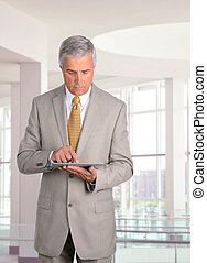 Businessman with Table Computer