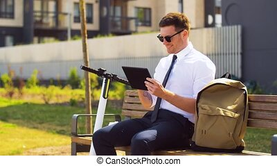 businessman with tablet computer, bag and scooter -...