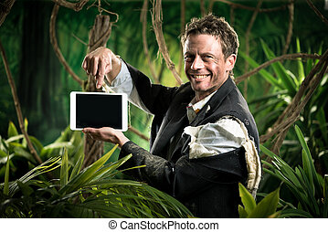 Businessman with tablet in the jungle - Businessman in...