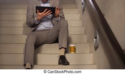 businessman with tablet pc and coffee on stairs - business,...