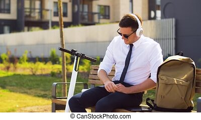 businessman with tablet pc, headphones and coffee -...